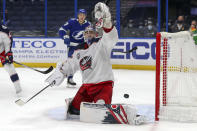 Columbus Blue Jackets goaltender Elvis Merzlikins gives up a goal to the Tampa Bay Lightning during the second period of an NHL hockey game Thursday, April 22, 2021, in Tampa, Fla. (AP Photo/Mike Carlson)