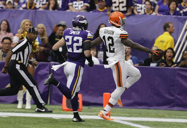 Cleveland Browns wide receiver Josh Gordon steps into the end zone ahead of Minnesota Vikings free safety Harrison Smith (22) while scoring on a 47-yard touchdown reception during the first half of an NFL football game Sunday, Sept. 22, 2013, in Minneapolis. (AP Photo/Ann Heisenfelt)