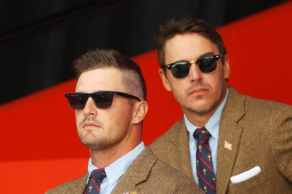 Bryson DeChambeau (pcitured left) and Brooks Koepka (pictured right) attend the opening ceremony for the 43rd Ryder Cup at Whistling Straits on September 23, 2021 in Kohler, Wisconsin.