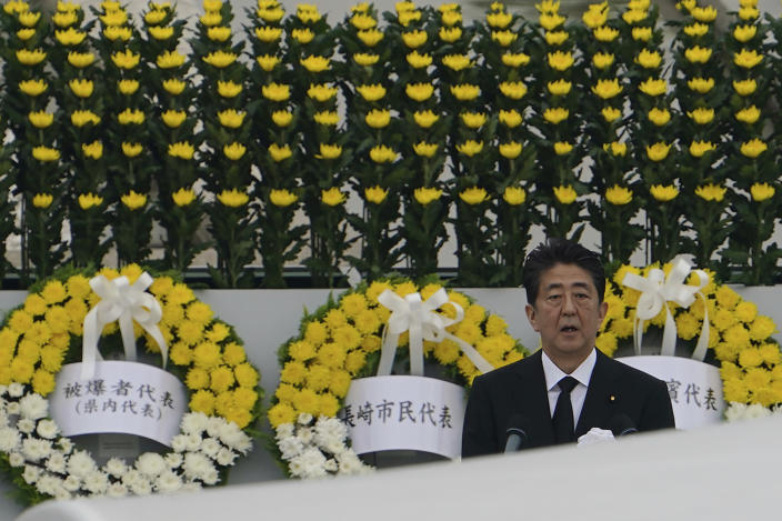 Japanese Prime Minister Shinzo Abe delivers a speech during a ceremony to mark the 75th anniversary of the bombing at the Hiroshima Peace Memorial Park Thursday, Aug. 6, 2020, in Hiroshima, western Japan. (AP Photo/Eugene Hoshiko)