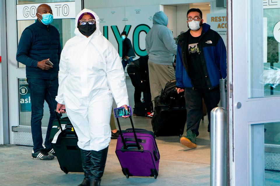 Passengers arrive at JFK International airport in New York (AFP via Getty Images)