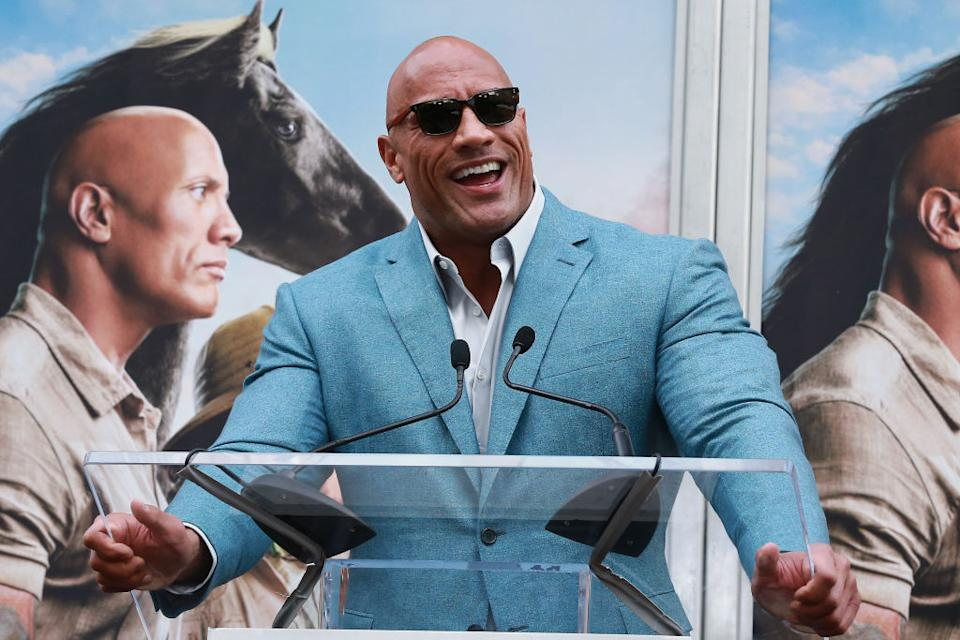 HOLLYWOOD, CALIFORNIA - DECEMBER 10: Dwayne Johnson speaks during Hand And Footprint Ceremony honoring Kevin Hart at TCL Chinese Theatre on December 10, 2019 in Hollywood, California. (Photo by Leon Bennett/WireImage)