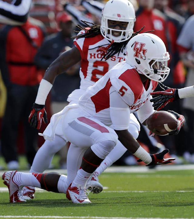 Houston defensive back Turon Walker (5) intercepts a Rutgers pass during the first half of an NCAA college football game, Saturday, Oct. 26, 2013, in Piscataway, N.J. (AP Photo/Mel Evans)