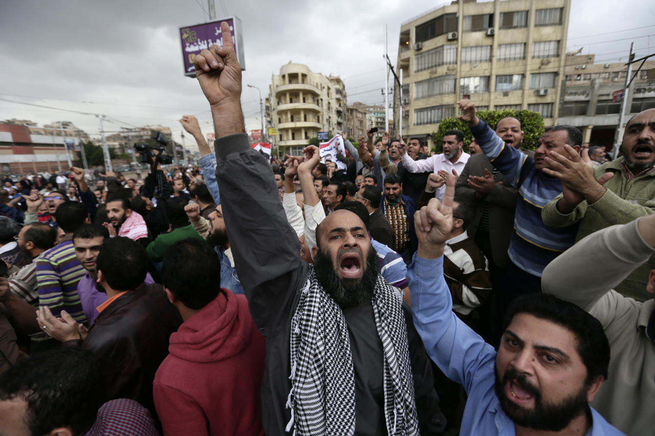 A supporter of Egyptian President Mohammed Morsi chants slogans during clashes with opponents, not pictured, outside the presidential palace, in Cairo, Egypt, Wednesday, Dec. 5, 2012. Wednesday's clashes began when thousands of Islamist supporters of Morsi descended on the area around the palace where some 300 of his opponents were staging a sit-in. (AP Photo/Hassan Ammar)