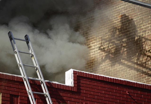 <p>A firefighter battles a blaze from a ladder that shot thick, black smoke into the sky over the downtown area, March 15, 2012, in Atlanta. Atlanta Fire Capt. Jolyon Bundridge said a restaurant was on fire. Bundridge was not aware of any injuries in the Thursday morning fire. (AP Photo/David Goldman) </p>