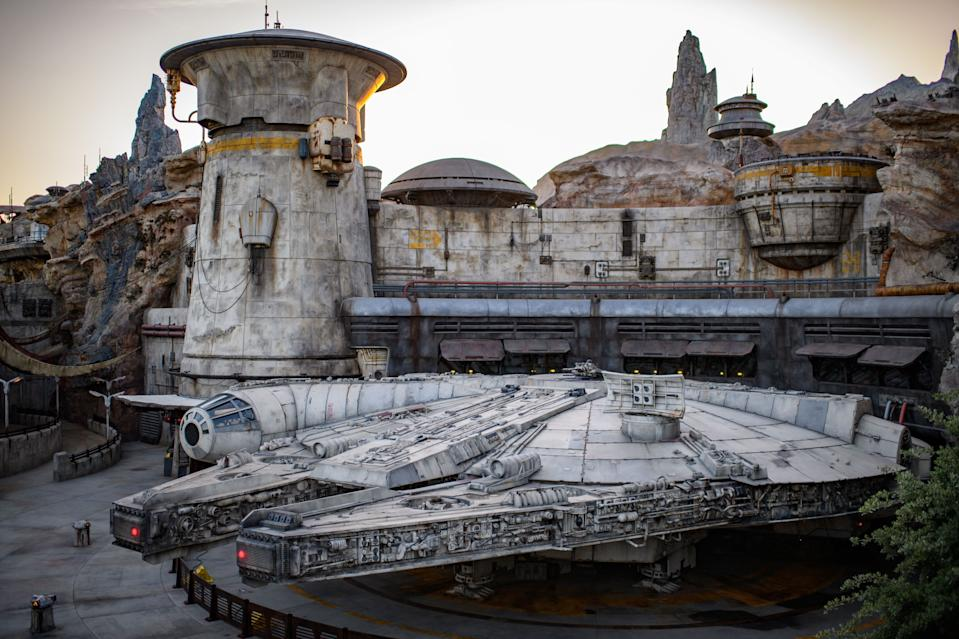 The Millennium Falcon docked at Batuu's Black Spire Outpost, a village named for the craggy dark petrified lock at the far left. (Richard Harbaugh/Disney Parks)