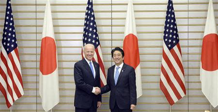 U.S. Vice President Joe Biden is welcomed by Japanese Prime Minister Shinzo Abe before their talks at Abe's official residence in Tokyo