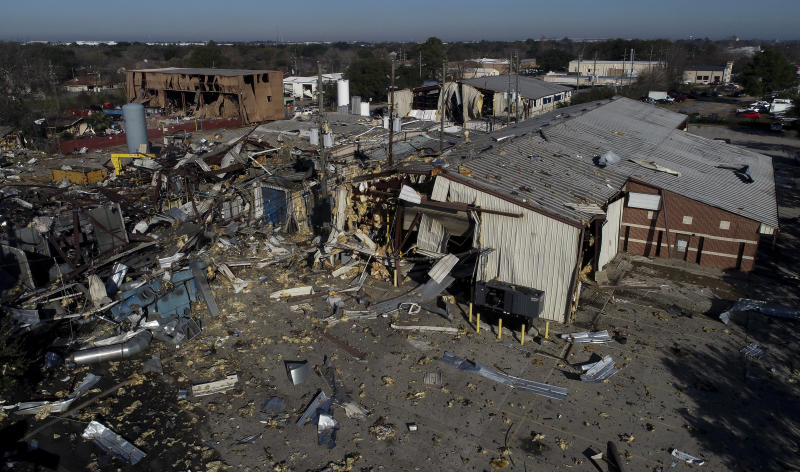 """This Jan. 24, 2020, file aerial photo shows the scene of an explosion that rocked northwest Houston. A company filed for bankruptcy Thursday, Feb. 6, 2020, in the wake of a massive explosion at one of its warehouses in Houston that killed two workers, injured 20 more and damaged hundreds of buildings. Watson Grinding and Manufacturing said it filed for Chapter 11 bankruptcy in Houston federal court because of what it expects to be """"a long-term interruption of business operations"""" due to the Jan. 24 blast. (Godofredo A. Vásquez/Houston Chronicle via AP)"""
