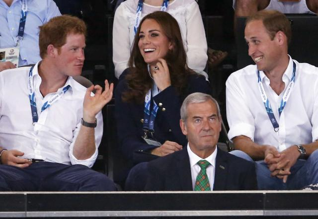 Catherine (C), Duchess of Cambridge, sits with her husband Britain's Prince William (R), and Britain's Prince Harry as they watch artistic gymnastics at the 2014 Commonwealth Games in Glasgow, Scotland, July 28, 2014. REUTERS/Jim Young (BRITAIN - Tags: SPORT GYMNASTICS ROYALS)