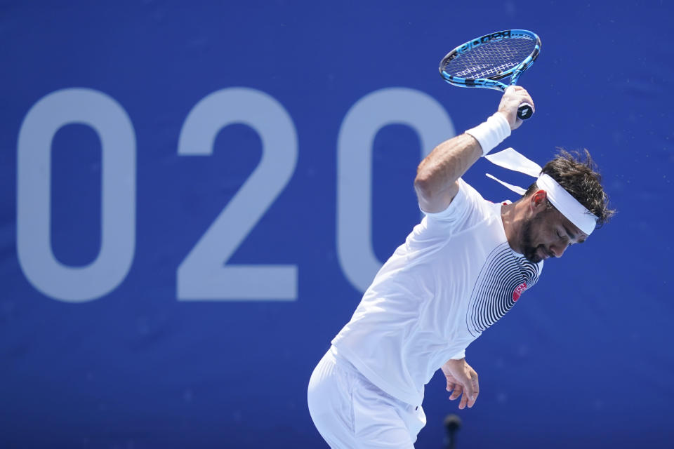 Fabio Fognini, of Italy, throws his racket during a third round men's tennis match against Daniil Medvedev, of the Russian Olympic Committee, at the 2020 Summer Olympics, Wednesday, July 28, 2021, in Tokyo, Japan. (AP Photo/Patrick Semansky)