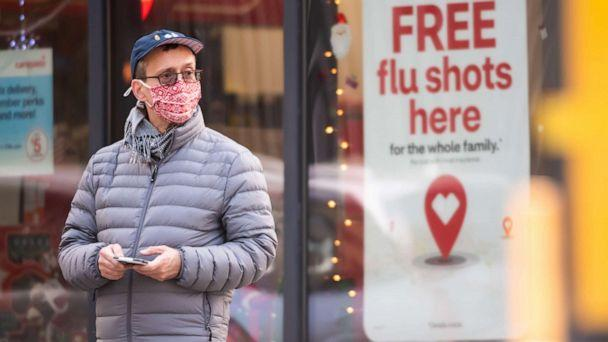 PHOTO: A person stands by a sign advertising flu shots at CVS as the city continues the reopening efforts following restrictions imposed to slow the spread of coronavirus on Dec. 1, 2020 in New York City. (Noam Galai/Getty Images, File)