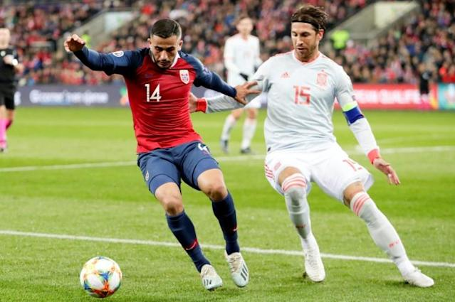 Sergio Ramos (right) takes on Norway defender Omar Elabdellaoui (AFP Photo/Tore Meek)