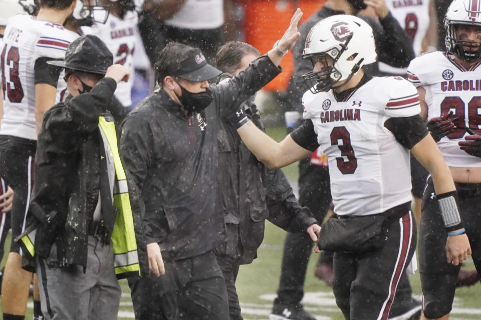 South Carolina head coach Will Muschamp celebrates with quarterback Ryan Hilinski (3) after South Carolina defeated Vanderbilt 41-7 in an NCAA college football game Saturday, Oct. 10, 2020, in Nashville, Tenn. (AP Photo/Mark Humphrey)