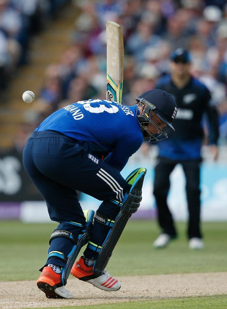 England's Jos Buttler gets hit by the ball during their first ODI match against New Zealand, at Edgbaston cricket ground in Birmingham, central England, on June 9, 2015 (AFP Photo/Adrian Dennis)