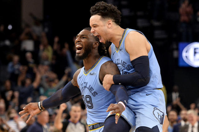Memphis Grizzlies forward Jae Crowder (99) and guard Dillon Brooks react after Crowder scored a winning three-point basket as time expired during overtime of an NBA basketball game against the Brooklyn Nets, Sunday, Oct. 27, 2019, in Memphis, Tenn. (AP Photo/Brandon Dill)