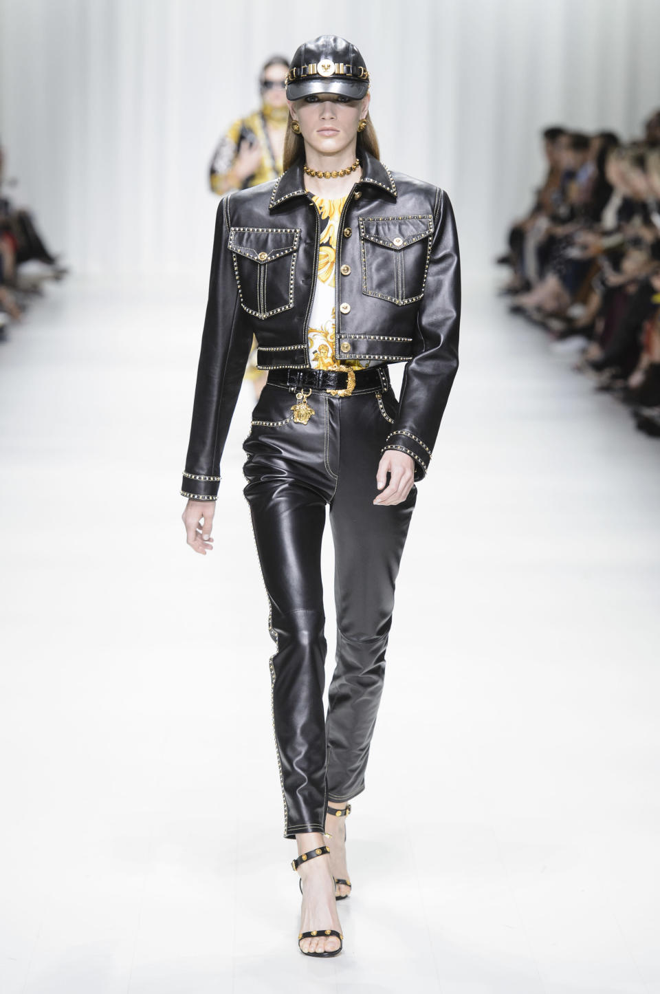 <p><i>A leather cap, jacket, and trousers came from the SS18 Versace collection. (Photo: ImaxTree) </i></p>