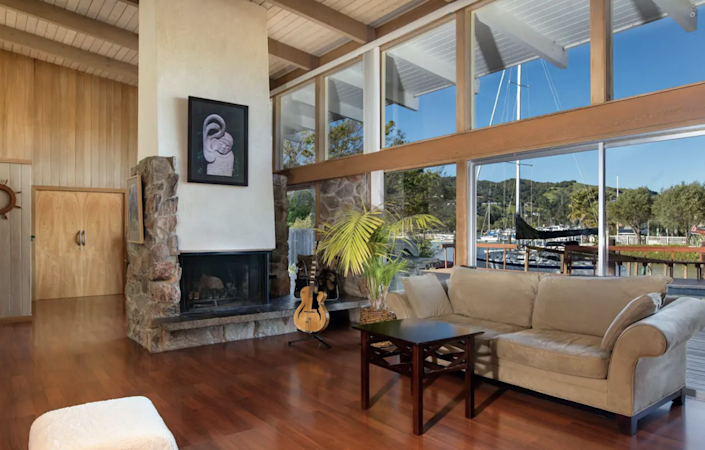 "Travel back in time with this 1960s midcentury-modern home meant to evoke a classic California feel. Promoted as a ""time capsule"" by the Airbnb hosts, this rare gem is located in a quiet waterfront neighborhood with bay views—but no TV or Wi-Fi to distract you—as well as a spacious living room and pool deck. Sitting right off San Rafael Creek, you'll be next to a federal waterway dredged by the Army Corps of Engineers in the early 20th century. But if boating is not for you, fear not. This home is conveniently located between San Francisco and Napa Valley, giving renters endless options for daytime activities and explorations. $328, Airbnb. <a href=""https://www.airbnb.com/rooms/16216454?federated_search_id=b8ccb5be-243a-450a-8ee6-409cbd208dbb&source_impression_id=p3_1618239516_w99wdyGGdiwNrAWI&guests=1&adults=1"" rel=""nofollow noopener"" target=""_blank"" data-ylk=""slk:Get it now!"" class=""link rapid-noclick-resp"">Get it now!</a>"