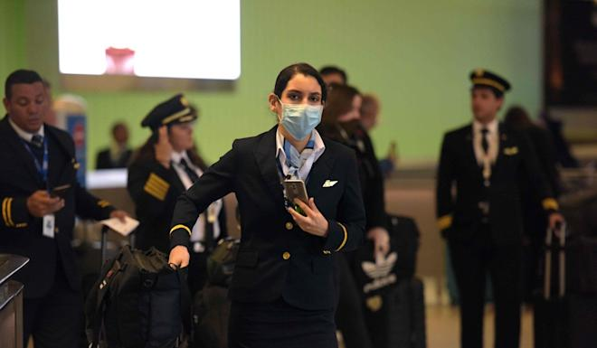 A flight attendant arrives at Tom Bradley terminal at Los Angeles International Airport in California. Some US$50 billion of a proposed US government economic stimulus package would target the battered airline industry. Photo: AFP