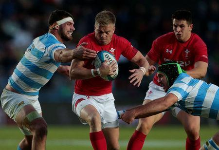 Rugby Union - June Internationals - Argentina v Wales - Brigadier General Estanislao Lopez Stadium, Santa Fe, Argentina - June 16, 2018 - Wales' Gareth Anscombe is tackled by Argentina's Marcos Kremer and Argentina's Matias Alemanno. REUTERS/Diego Lima