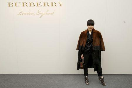 Actress Noomi Rapace arrives for Burberry. REUTERS/Luke MacGregor
