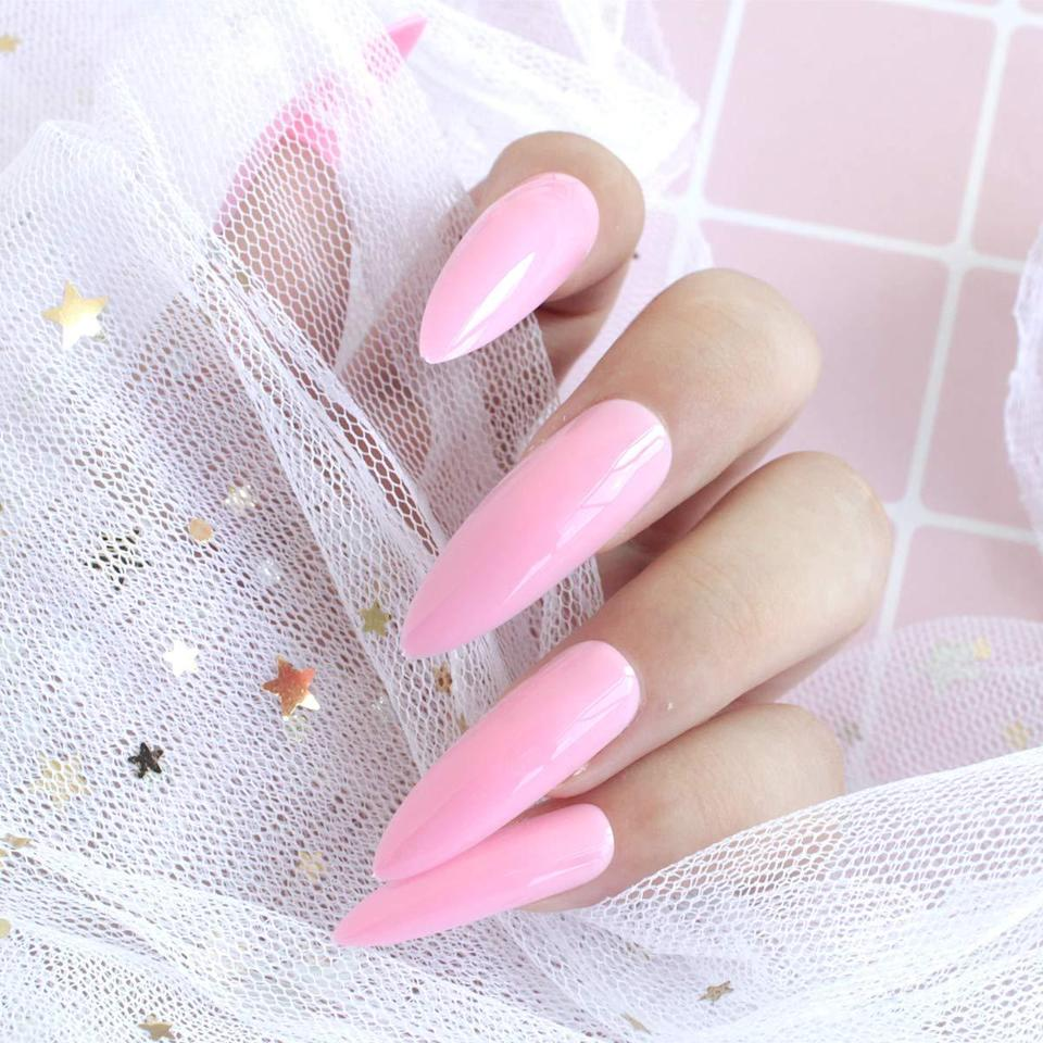 "<p>Ringing in at just $4 for a 24-piece set, you can buy multiple sets of the Justotry Solid Color Long Press-On Nails and still stay under budget. Mix and match colors to create a <a href=""https://www.allure.com/story/nail-trends-2021?mbid=synd_yahoo_rss"" rel=""nofollow noopener"" target=""_blank"" data-ylk=""slk:multi-colored mani"" class=""link rapid-noclick-resp"">multi-colored mani</a> (another forecasted 2021 trend) or throw on some gems like <a href=""https://www.amazon.com/gp/customer-reviews/R2K94PUM9YX0T0/ref=cm_cr_othr_d_rvw_ttl?ie=UTF8&ASIN=B088TFQGS8"" rel=""nofollow noopener"" target=""_blank"" data-ylk=""slk:this reviewer"" class=""link rapid-noclick-resp"">this reviewer</a> did. Whether you're feeling Barbie pink, metallic silver, or all-over lilac glitter, there's a set for every mood and aesthetic. If you want your fake nails to last even longer, be sure to seal them down with glue for a stronger hold, instead of using adhesive stickers.</p> <p><strong>$4</strong> (<a href=""https://www.amazon.com/24Pcs-Stiletto-Acrylic-Ballerina-Adhesive/dp/B088TJQWXP"" rel=""nofollow noopener"" target=""_blank"" data-ylk=""slk:Shop Now"" class=""link rapid-noclick-resp"">Shop Now</a>)</p>"
