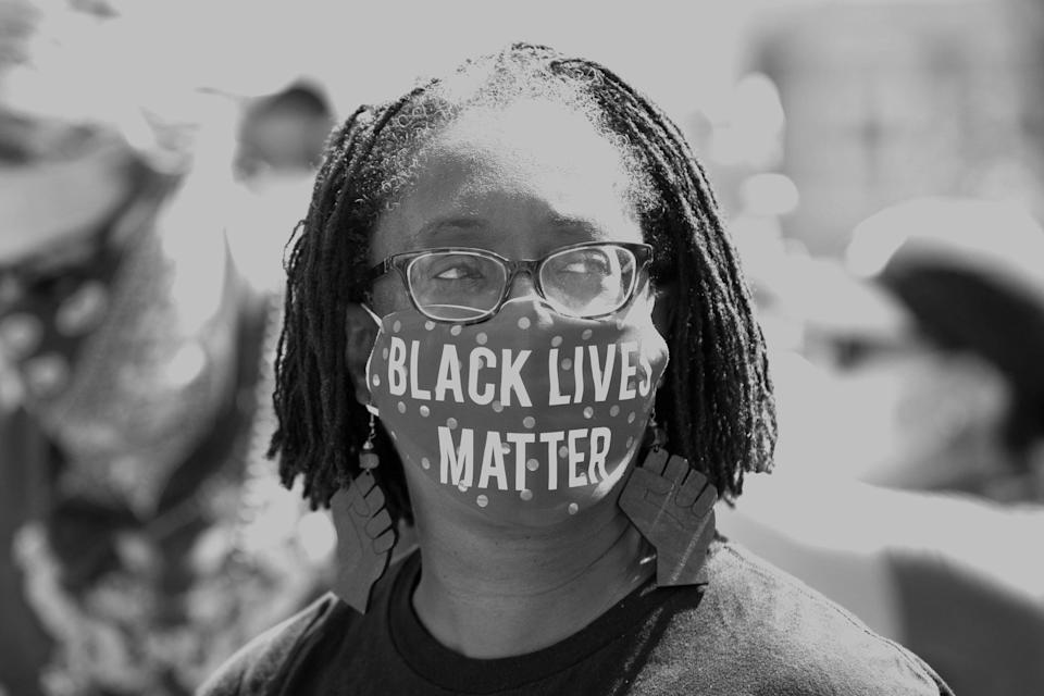 Lisa Woolfork wears a Black Lives Matter mask during a racial justice protest in Charlottesville, Virginia, on May 30, 2020. (Photo: RYAN M. KELLY/AFP/Getty Images)