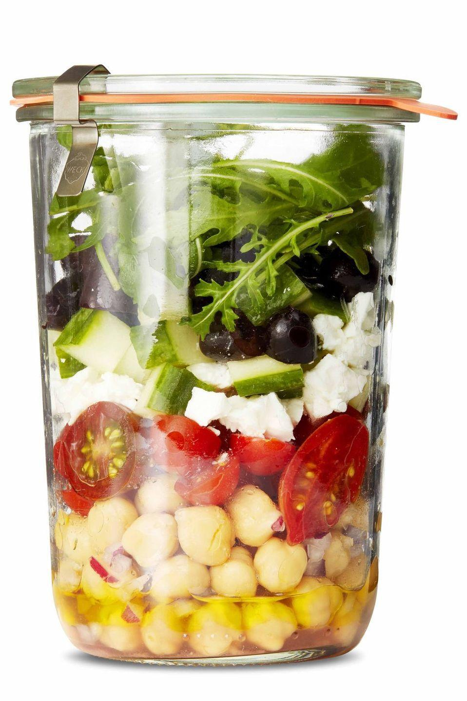 """<p>This 10-minute meatless salad could work as a last-minute appetizer or quick lunch. </p><p><a href=""""https://www.womansday.com/food-recipes/food-drinks/a25941107/marinated-chickpea-greek-salad-recipe/"""" rel=""""nofollow noopener"""" target=""""_blank"""" data-ylk=""""slk:Get the recipe for Marinated Chickpea Greek Salad."""" class=""""link rapid-noclick-resp""""><strong><em>Get the recipe for Marinated Chickpea Greek Salad.</em></strong></a></p>"""