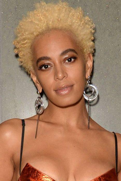 <p>One day long brunette curls, the next it's platinum braids and before you know it Solange has gone and nailed the best blonde curly pixie crop we've seen in a long time. Created by hairstylist Chuck Amos, we're feeling Solange's new halo of hair.</p>