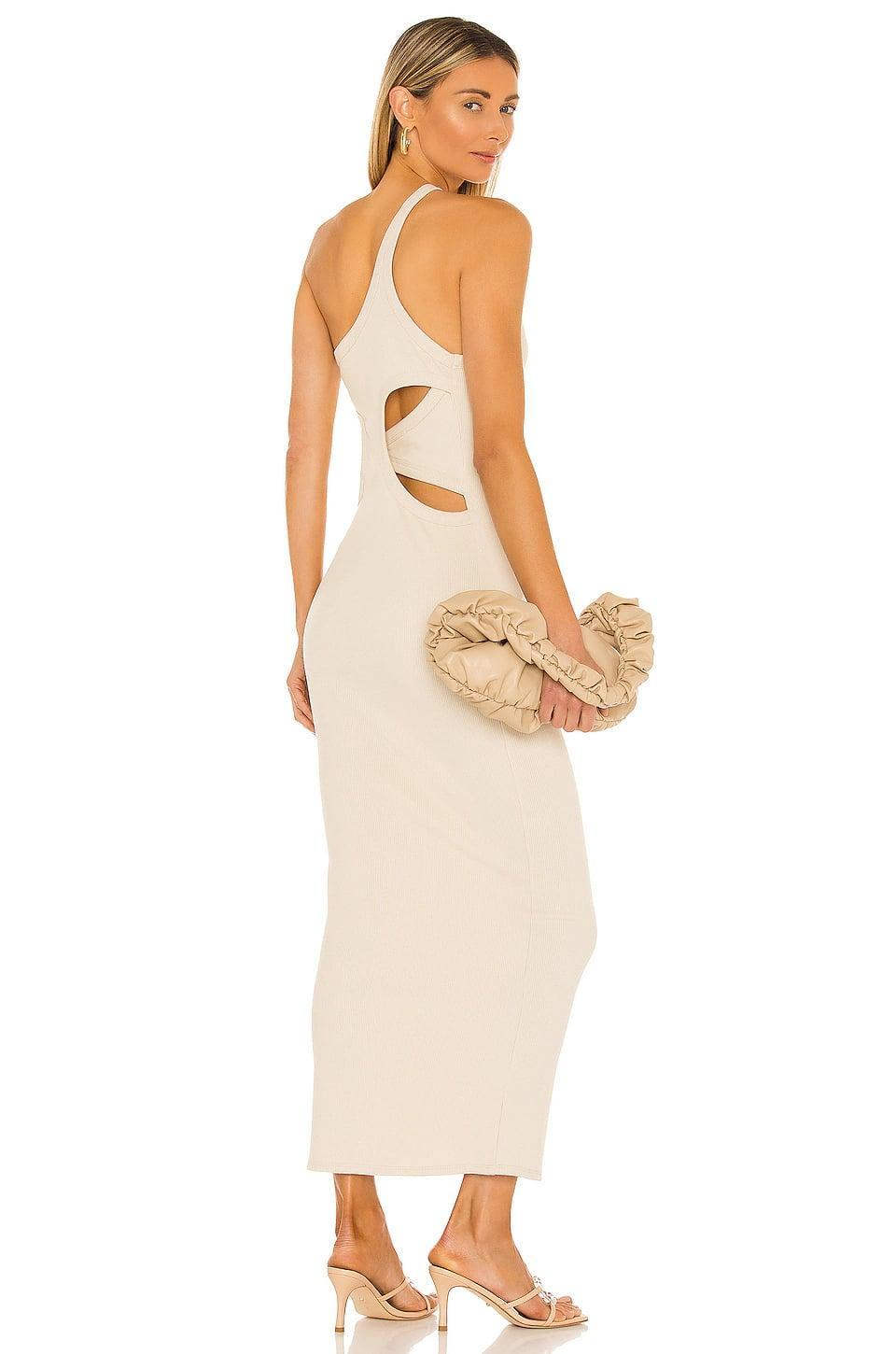 <p>We love the unique cutouts on this <span>The Line by K Gael Dress</span> ($150).</p>