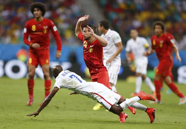 DaMarcus Beasley of the U.S. fights for the ball withBelgium's Dries Mertens during their 2014 World Cup round of 16 game at the Fonte Nova arena in Salvador July 1, 2014. REUTERS/Marcos Brindicci (BRAZIL - Tags: SOCCER SPORT WORLD CUP)