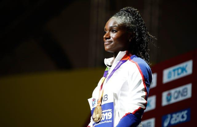 Dina Asher-Smith on the podium after receiving her 200m gold medal at the 2019 World Championships in Doha