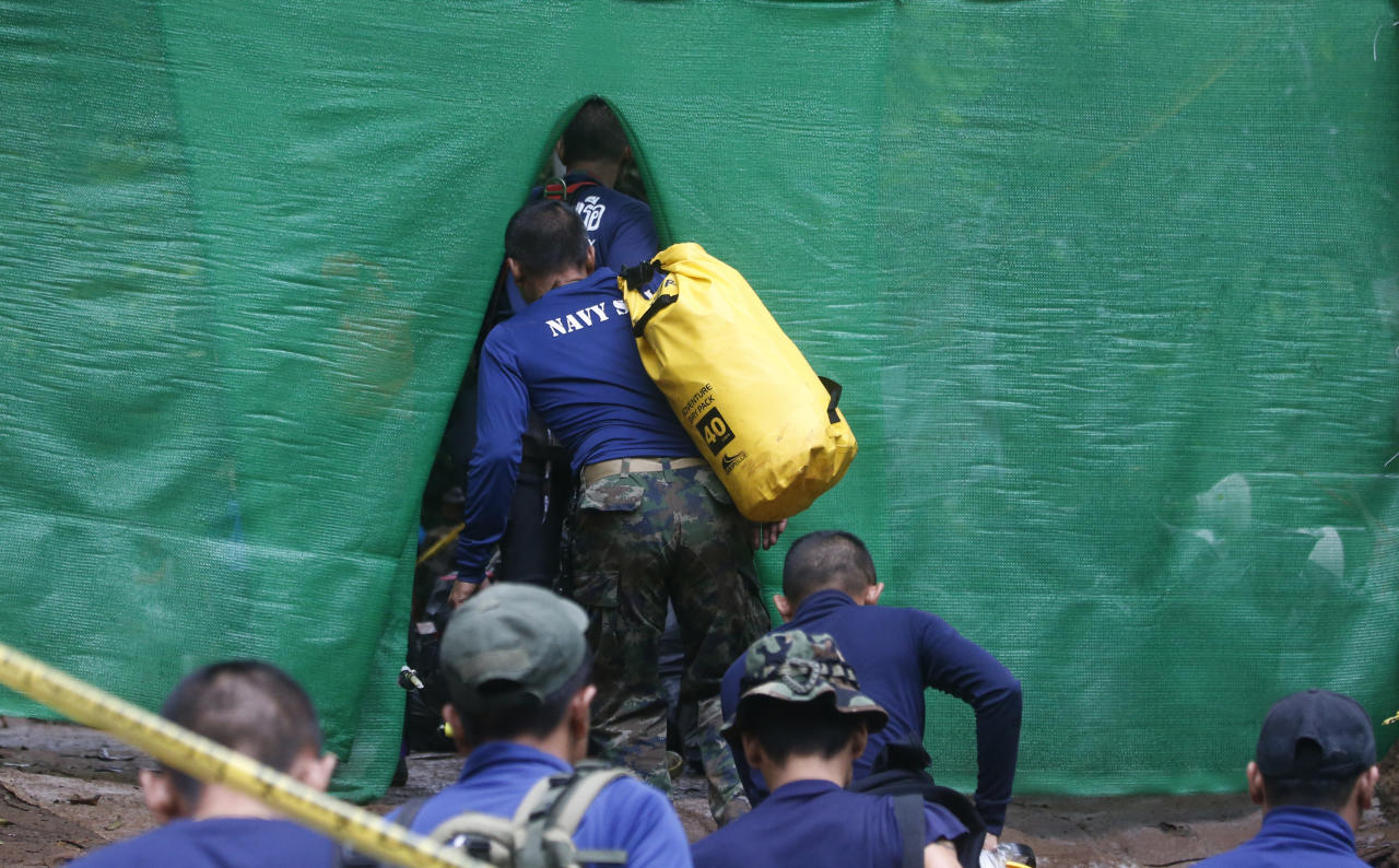 <p>Rescuer arrive on Sunday (8 July) near the flooded cave in Chiang Rai, Thailand, where 12 boys and their soccer coach have been trapped since 23 June., in Mae Sai, Chiang Rai province, in northern Thailand Sunday, July 8, 2018. (PHOTO: AP) </p>