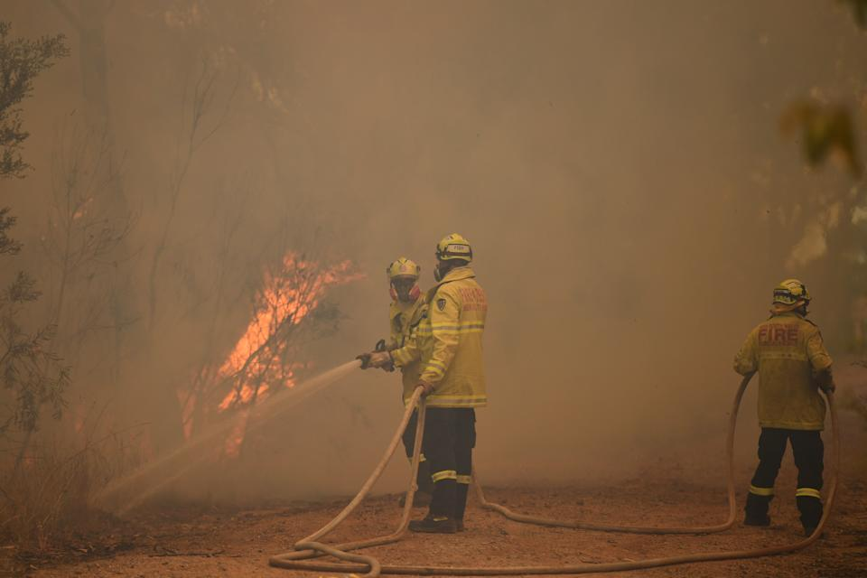 New South Wales Rural Fire Service and Fire and Rescue NSW crews continue with containment measures at the out of control Gospers Mountain fire along the Bells Line of Road in the Blue Mountains north west of Sydney.