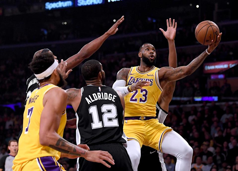 LeBron James drilled his first huge shot as a member of the Lakers on Monday night, sending the Lakers into overtime against the Spurs with a last-second 3-point bucket. (Getty Images)