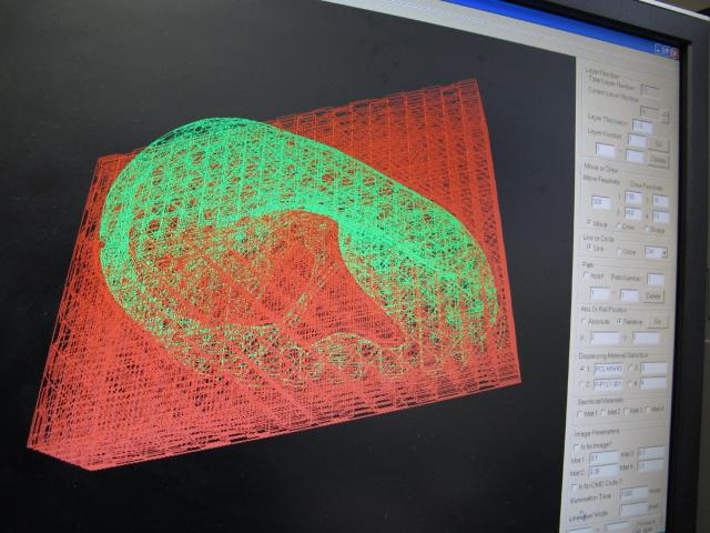 "A computer displays an image of the ""scaffolding"" for a human ear being created by a nearby printer in a laboratory at Wake Forest University in Winston-Salem, N.C. on Wednesday, May 8, 2013. The university is experimenting with various ways to create replacement organs for human implantation, from altering animal parts to building them from scratch with a patient's own cells. (AP Photo/Allen Breed)"