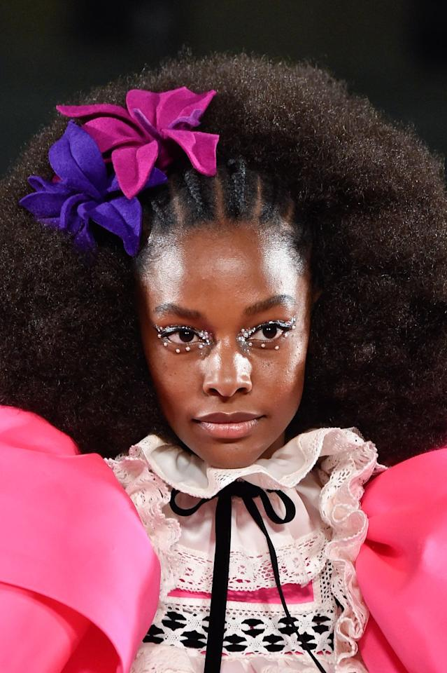 <p>There were a number of kitschy hair accessories on the Marc Jacobs runway, but the '70s-inspired faux orchids were among the most wearable and fun.</p>