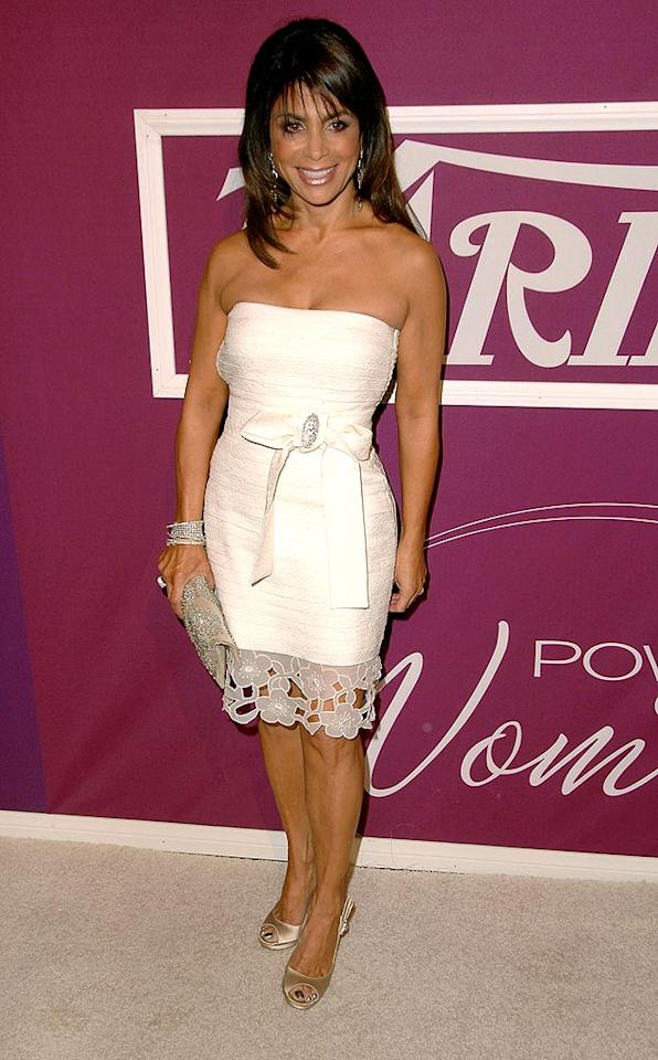 """Former """"Idol"""" judge Paula Abdul smiled while sporting a super cute ivory mini, bangle bracelets, and metallic shoes. Steve Granitz/<a href=""""http://www.wireimage.com"""" target=""""new"""">WireImage.com</a> - September 24, 2009"""