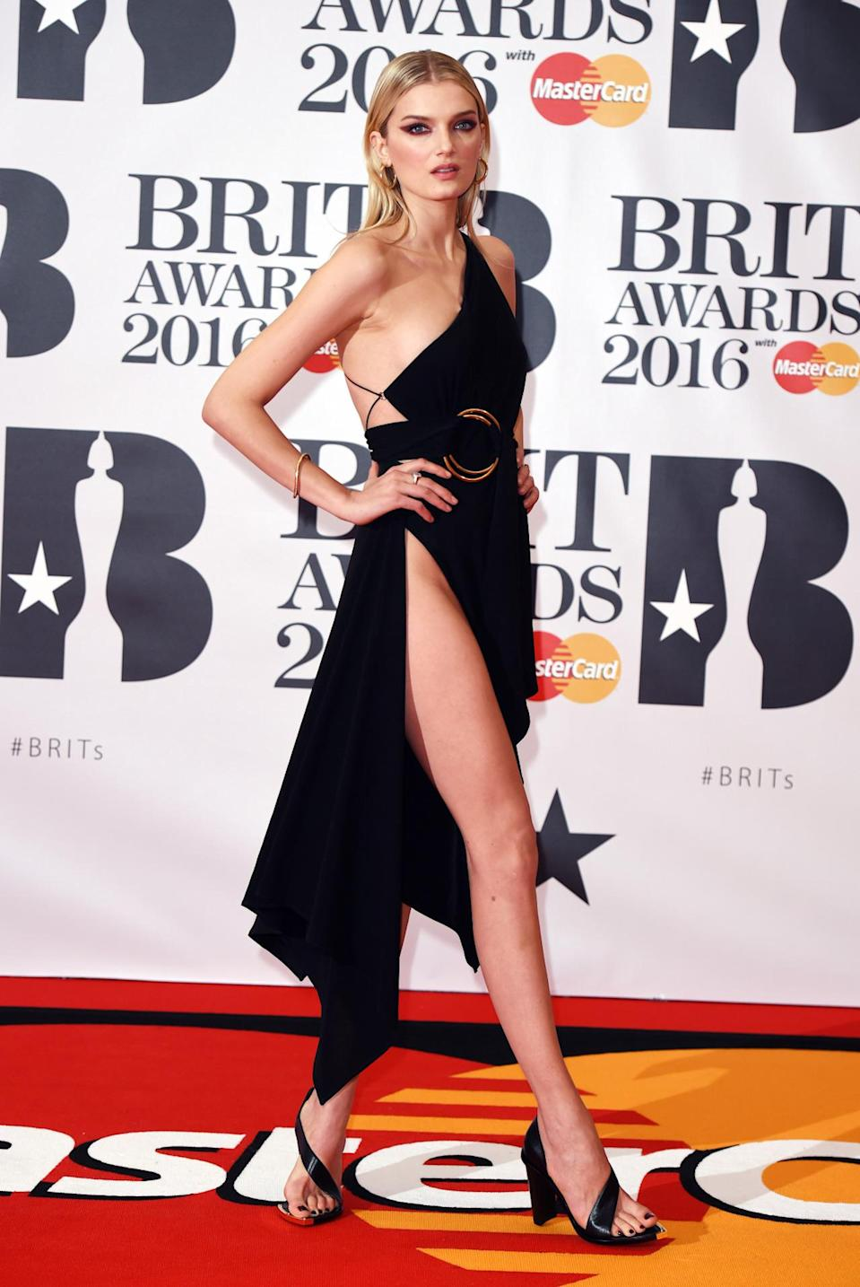 <p>The British model upped the ante in a VERY revealing black gown. <i>[Photo: Rex]</i></p>