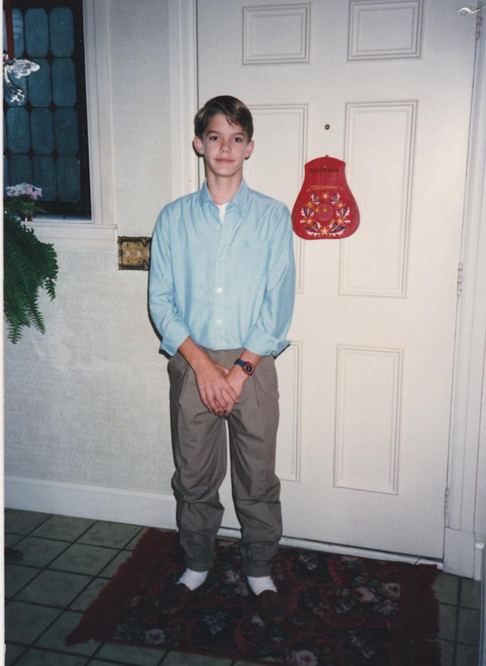 A photo provided by Nate Lindstrom shows him at age 14 on the first day of his freshman year of high school.