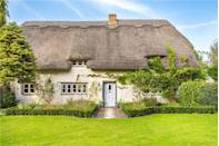 """<p>Like something out of a picture book, this beautiful white characterful cottage has four bedrooms, tasteful <a href=""""https://www.countryliving.com/uk/homes-interiors/interiors/a35202032/spring-summer-interior-trends/"""" rel=""""nofollow noopener"""" target=""""_blank"""" data-ylk=""""slk:interiors"""" class=""""link rapid-noclick-resp"""">interiors</a>, two bathrooms, and large wrap-around gardens. Tempted? You'll need £1.2 million to make this your home...</p><p><a href=""""https://www.zoopla.co.uk/for-sale/details/56505757"""" rel=""""nofollow noopener"""" target=""""_blank"""" data-ylk=""""slk:This property is currently on the market for £1,275,000 with Scott Fraser via Zoopla."""" class=""""link rapid-noclick-resp"""">This property is currently on the market for £1,275,000 with Scott Fraser via Zoopla.</a><br></p>"""
