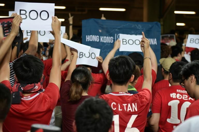 Hong Kong fans turned their backs and booed when the Chinese national anthem was played