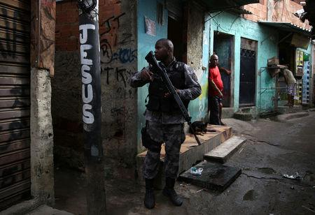 A military police officer patrols the Kelson's slum during an operation against crime in Rio de Janeiro