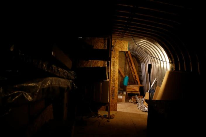 The interior of an underground shelter at a survival camp
