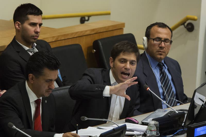 "Argentina's Economy Minister Axel Kicillof gives an address ""Sovereign Debt Restructuring: The Case of Argentina"" next to Sacha Llorenti, Chairman of the Group of G77 at United Nations headquarters in New York"