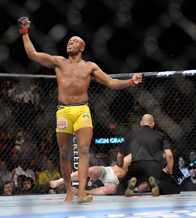 Anderson Silva celebrates after the referee stopped the fight in the second round during his UFC 148 middleweight championship fight against Chael Sonnen at the MGM Grand Garden Arena Saturday, July 7, 2012 in Las Vegas. Silva won with a TKO. (AP Photo/David Becker)