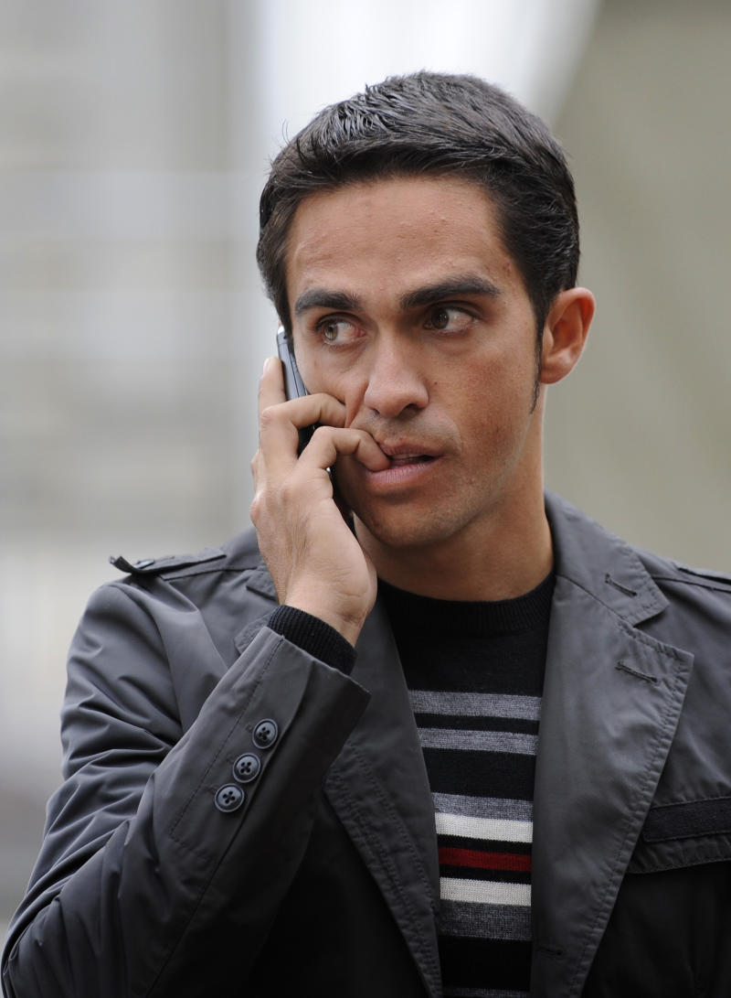 FILE - In this Oct. 30, 2010 file photo, cyclist Alberto Contador of Spain speaks on a cell phone in Oviedo, Spain. The Spanish cycling federation was nearing a decision in Alberto Contador's case as Spanish reports suggested he will not be banned for failing a doping test, clearing the way for him to keep his Tour de France title. Spanish cycling federation head Juan Carlos Castano told The Associated Press the disciplinary committee is still deliberating with the official decision not expected before late Monday, Feb. 14, 2011. (AP Photo/Paco Paredes, File)