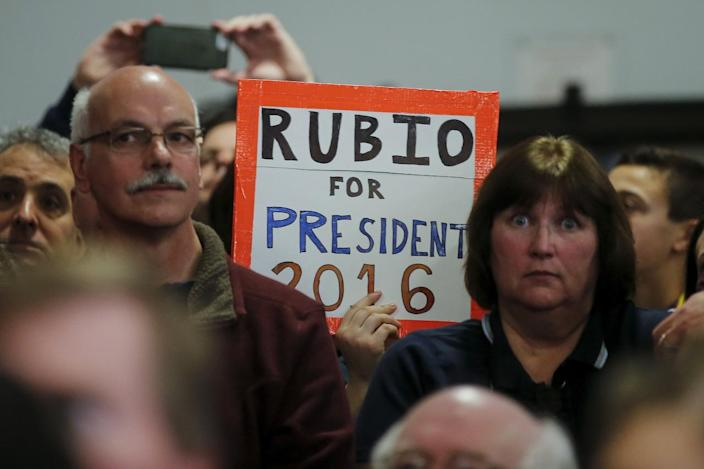 <p>A woman holds up a sign as Republican presidential candidate Marco Rubio speaks at a campaign event in Bedford, N.H., on Feb. 7, 2016. <i>(Photo: Carlo Allegri/Reuters)</i></p>