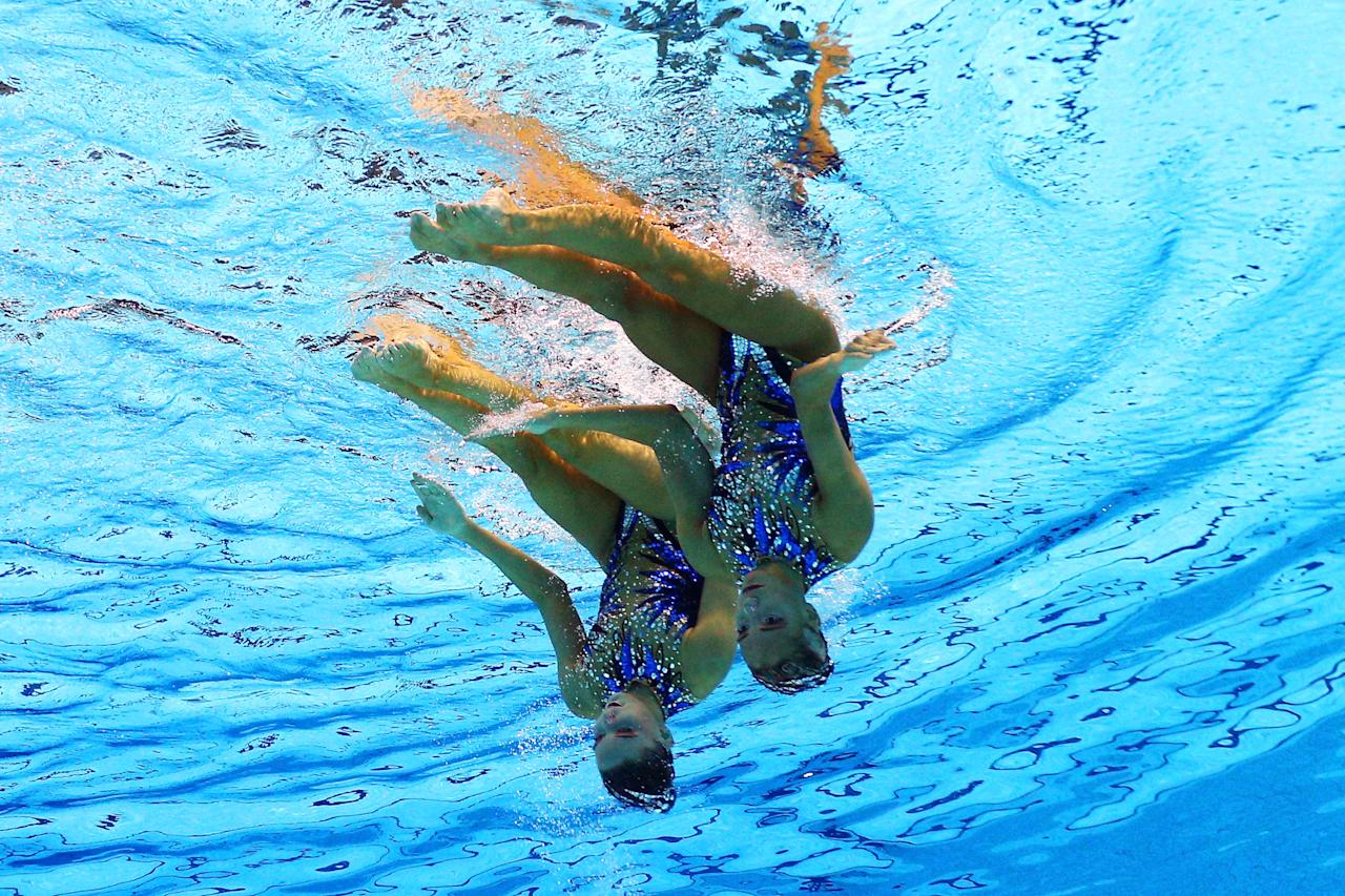 Olivia Federici and Jenna Randall of Great Britain compete in the Women's Duets Synchronised Swimming Free Routine Preliminary on Day 10 of the London 2012 Olympic Games at the Aquatics Centre on August 6, 2012 in London, England.  (Photo by Clive Rose/Getty Images)