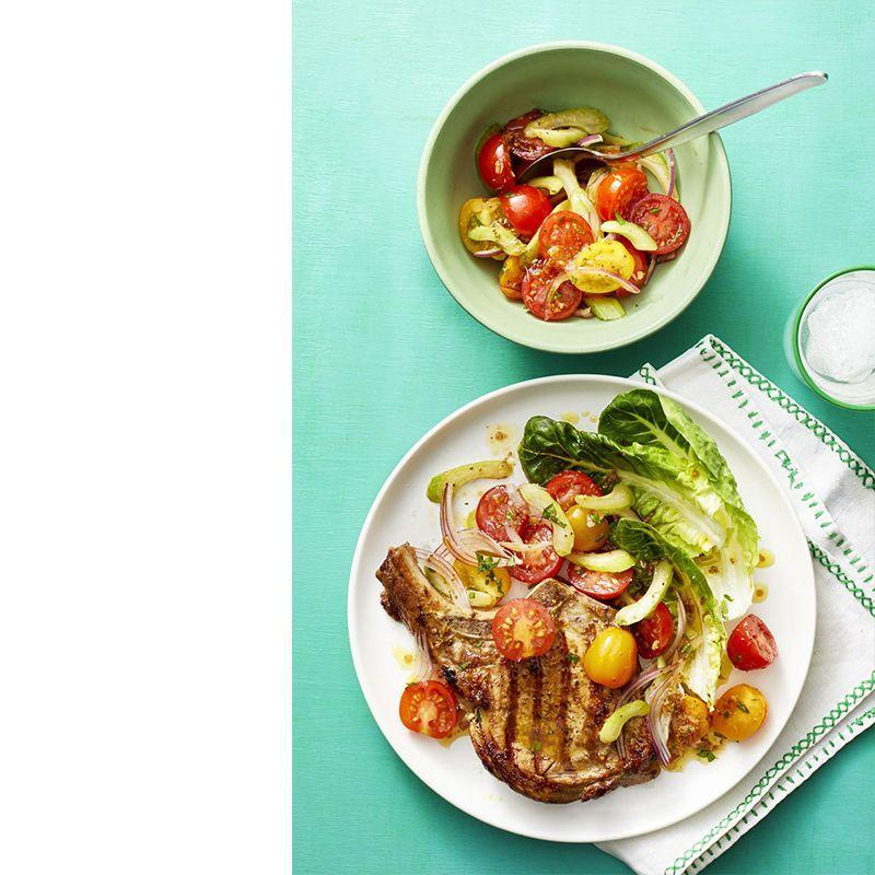 """<p>It takes less than half an hour to prepare and cook this recipe, but we're sure you'll devour it in just a couple of minutes!</p><p><a href=""""https://www.womansday.com/food-recipes/food-drinks/a22481418/pork-chops-with-bloody-mary-tomato-salad-recipe/"""" rel=""""nofollow noopener"""" target=""""_blank"""" data-ylk=""""slk:Get the Pork Chops with Bloody Mary Tomato Salad recipe."""" class=""""link rapid-noclick-resp""""><em>Get the Pork Chops with Bloody Mary Tomato Salad recipe.</em></a></p>"""