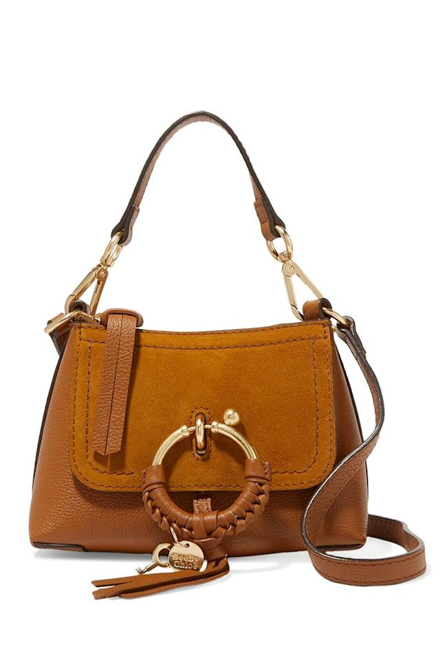 """<p>Joan mini textured-leather and suede shoulder bag, £260, See by Chloé</p><p><a class=""""body-btn-link"""" href=""""https://go.redirectingat.com?id=127X1599956&url=https%3A%2F%2Fwww.net-a-porter.com%2Fgb%2Fen%2Fproduct%2F1135540%2Fsee_by_chloe%2Fjoan-mini-textured-leather-and-suede-shoulder-bag&sref=http%3A%2F%2Fwww.cosmopolitan.com%2Fuk%2Ffashion%2Fstyle%2Fg4098%2Fshop-best-designer-handbags-under-300%2F"""" target=""""_blank"""">BUY NOW</a></p><p>Brown Chloé suede is a classic for a reason. Plus, with the return of cowboy chic, there's never been a better time to treat yourself to a beauty like this, complete with two different strap options.</p>"""